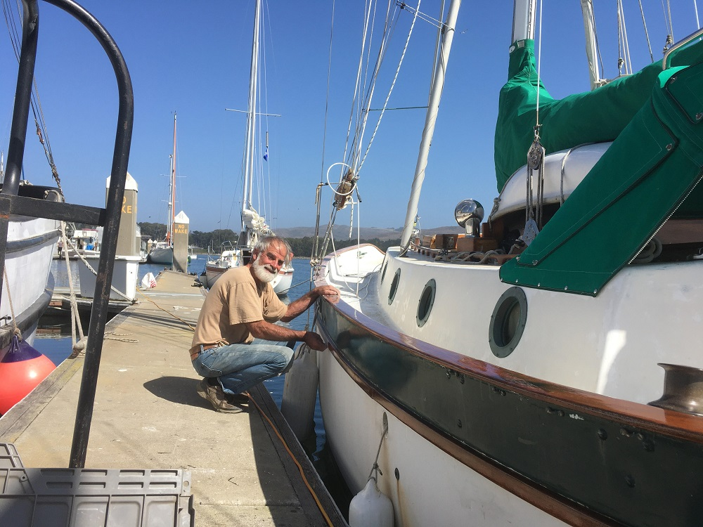 Name:  Doug Lamb varnishing Pelican.jpg Views: 88 Size:  247.7 KB