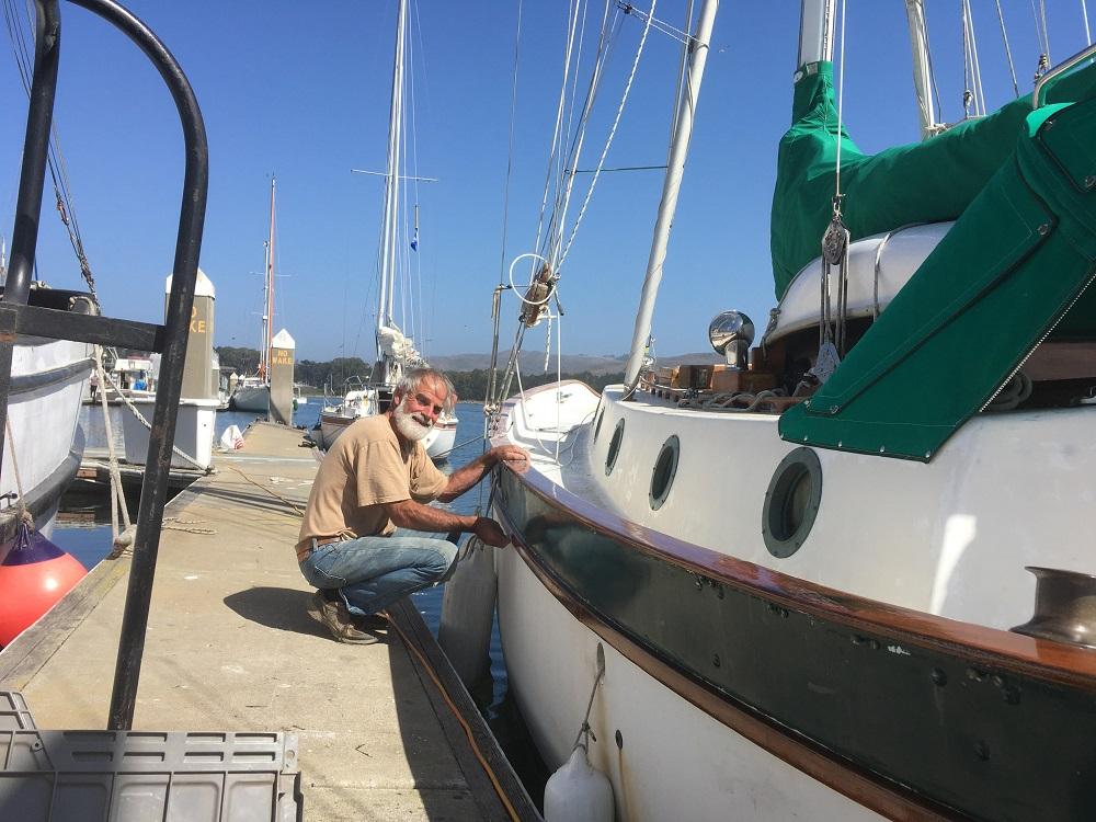 Name:  Doug Lamb varnishing Pelican.jpg Views: 75 Size:  247.7 KB